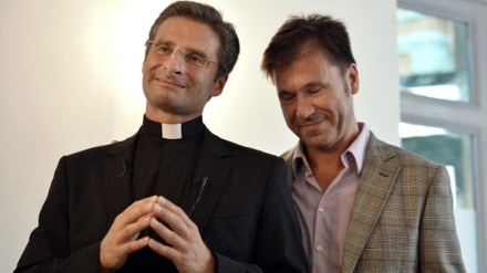 "Father Krysztof Olaf Charamsa (L), who works for a Vatican office, gives a press conference with his partner Edouard to reveal his homosexuality on October 3, 2015 in Rome. The priest said he wanted to challenge what he termed the Church's ""paranoia"" with regard to sexual minorities, claiming the Catholic clergy was largely made up of intensely homophobic homosexuals. The Vatican condemned the coming out of a Polish priest on the eve of a major synod as a ""very serious and irresponsible,"" act which meant he would be stripped of his responsibilities in the Church's hierarchy. In a statement, a spokesman said Krzystof Charamsa would not be able to continue in his senior position in the Vatican and that his future as a priest would be decided by his local bishop.  (Tiziana Fabi / Getty Images)"
