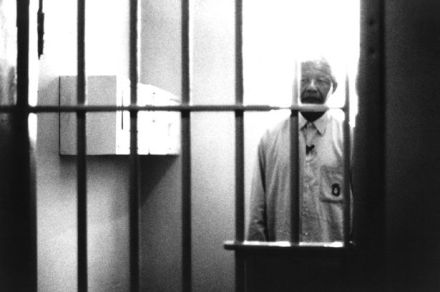 Nelson Mandela visiting his former prison cell at Robben Island