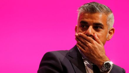 shadow-justice-minister-sadiq-khan-reacts-as-he-listens-to-yvette-cooper-britain-s-opposition-labour-party-s-shadow-home-secretary-speaks-at-the-party-s-conference-in-manchester_5413579.jpg
