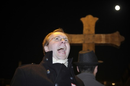 "Belgian Alain Escada, Secretary General of the Civitas Institute, speaks next to a cross as hundreds of fundamenlist Christians demonstrate outside Brittany's National Theatre on November 10, 2011 in Rennes, western Francen against Italian director Romeo Castellucci's play, entitled ""Sur le concept du visage du fils de Dieu"" (On the Concept of the Face, Regarding the Son of God).   AFP PHOTO DAMIEN MEYER / AFP PHOTO / DAMIEN MEYER"