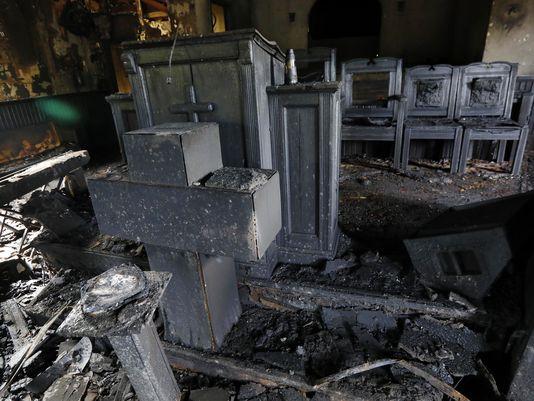 636137642163896732-black-church-burned-m-gate