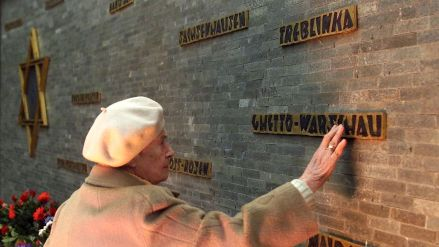 an-elderly-woman-touches-the-memorial-for-the-jewish-victims-of-the-nazi-holocaust-with-names-of-dif_5741755