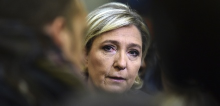 France's Front National (FN) far-right party's President and presidential candidate for the 2017 election Marine Le Pen speaks to a journalist at the Fermap manufacturing factory in Forbach, eastern France, on January 18, 2017.  / AFP PHOTO / PATRICK HERTZOG